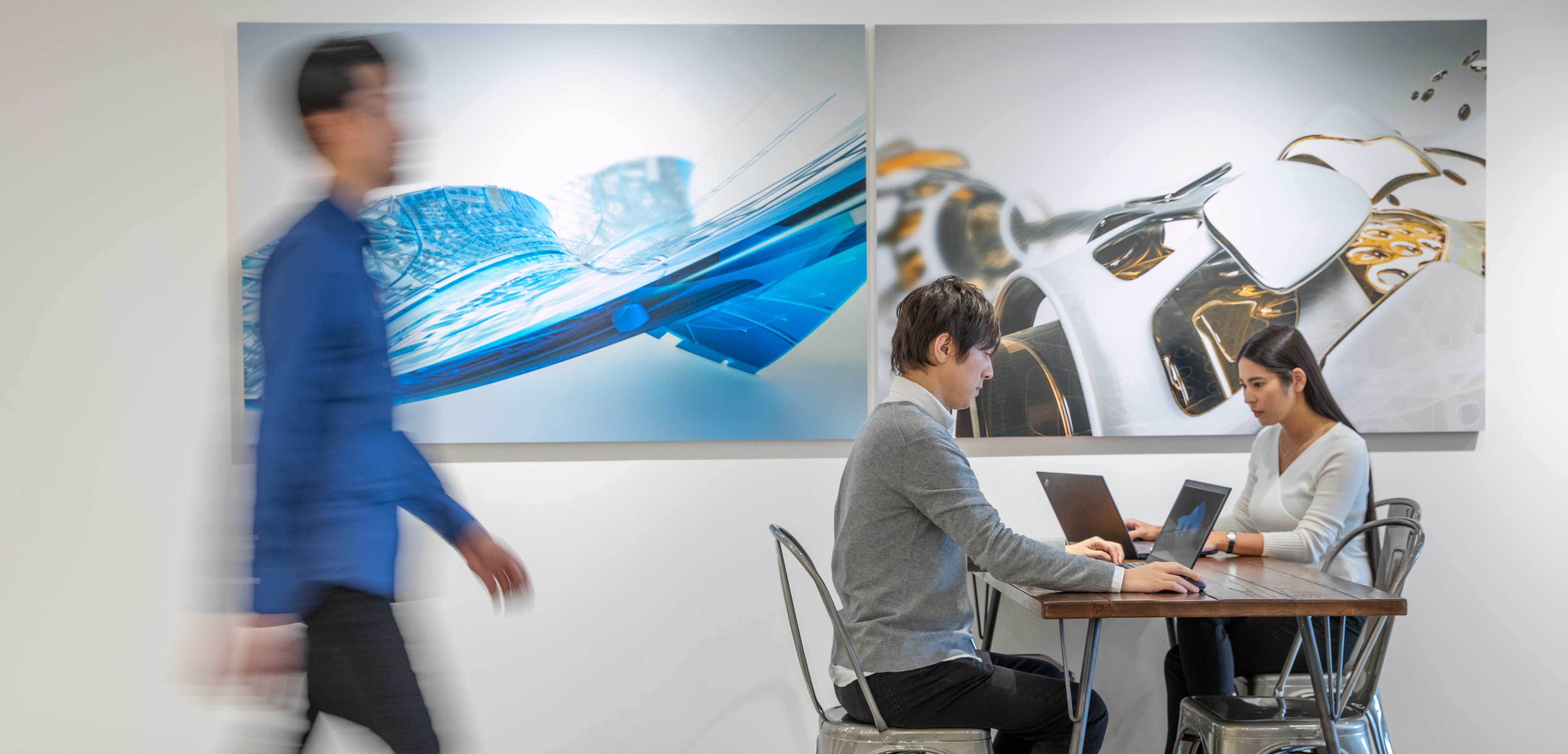 Autodesk Employees at Tokyo Office with Product Images in the back