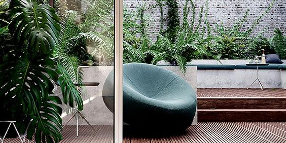 Renderización 3D de silla en un patio con plantas