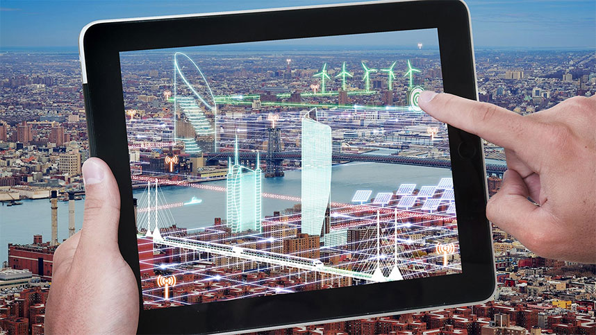 pair of hands using tablet for 3d mapping in construction