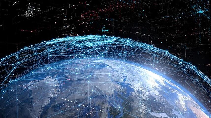 Vy över jorden sedd från rymden omgiven av ett nät av ljuspunkter
