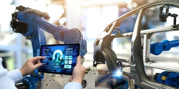 Image showing man using technology to check the manufacturing process of a car