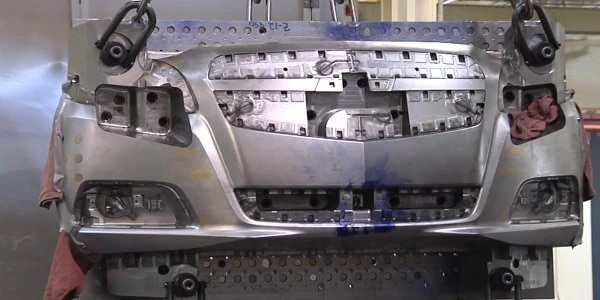 This is an example of a mold for the bumper of a car.