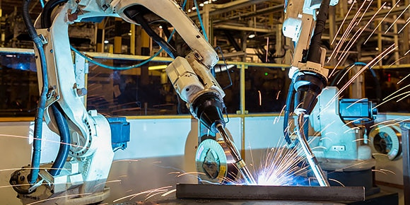 Two machines welding in a technology laboratory