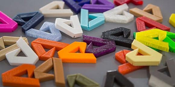 Multi-colored Autodesk logo cutouts