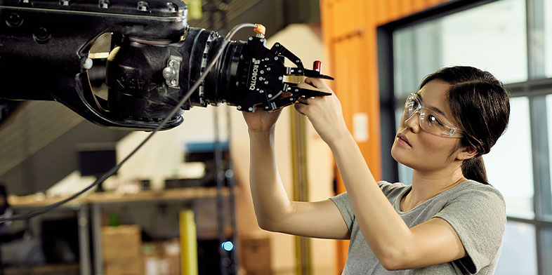 Woman working with AutoCAD and robotics at Autodesk's San Francisco Technology Center.