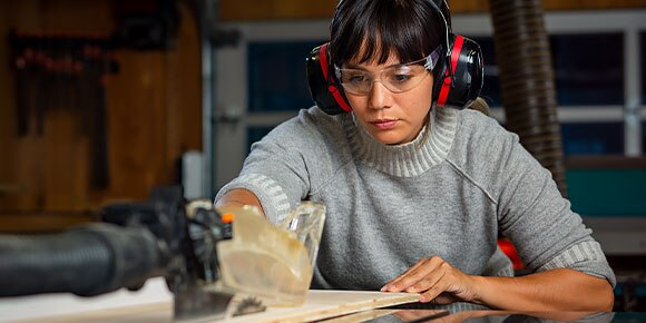 A woman working in the wood shop at the Autodesk San Francisco Technology Center.