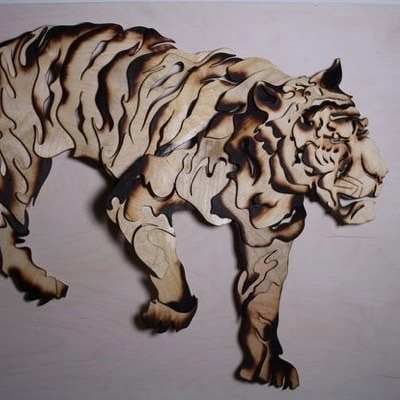 Tiger sculpture from scrap wood by Yue Shi