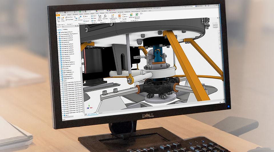 데스크톱 모니터에 표시된 Inventor 사용자 인터페이스 내의 산업용 기계 설계