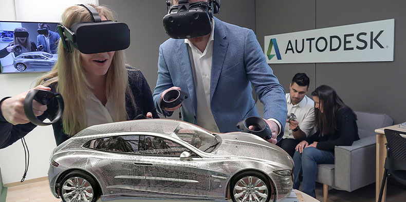 Two people wearing virtual reality headsets manipulate a 3D model of a car