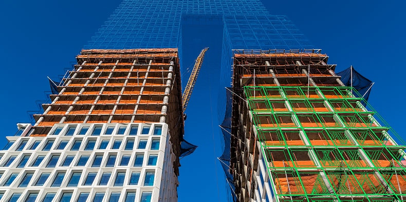 Two high-rise towers of the Domino Sugar Factory redevelopment project in Brooklyn, New York shown with wireframe overlay