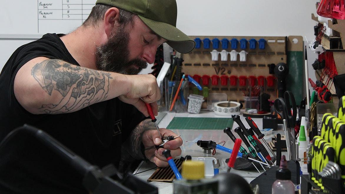 Ego founder Richard Beston designing tattoo machines at a desk