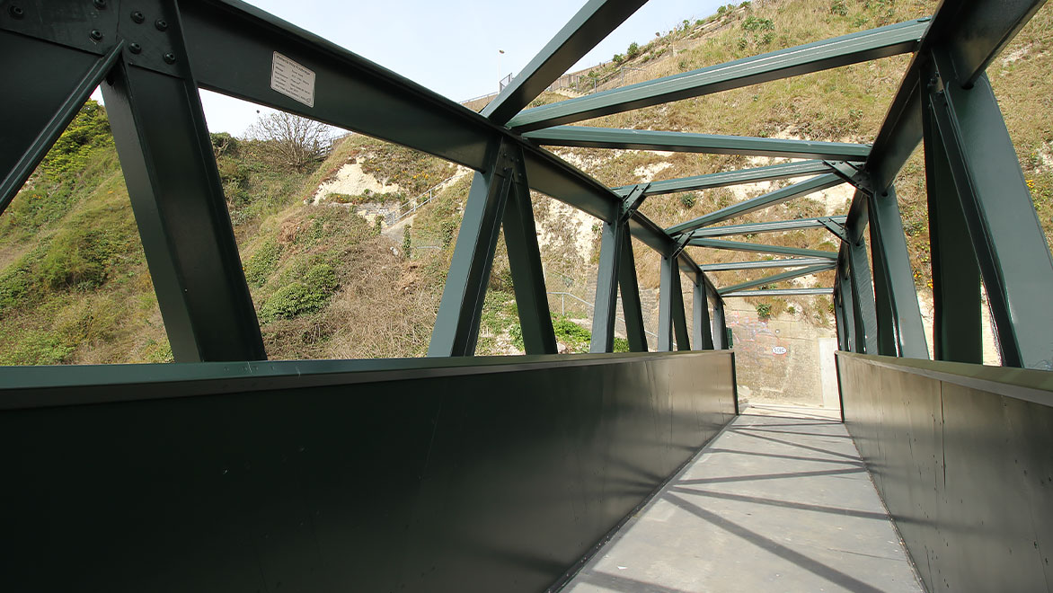 Image shows a close-up of the fibre-glass beams and connectors after the footbridge was installed