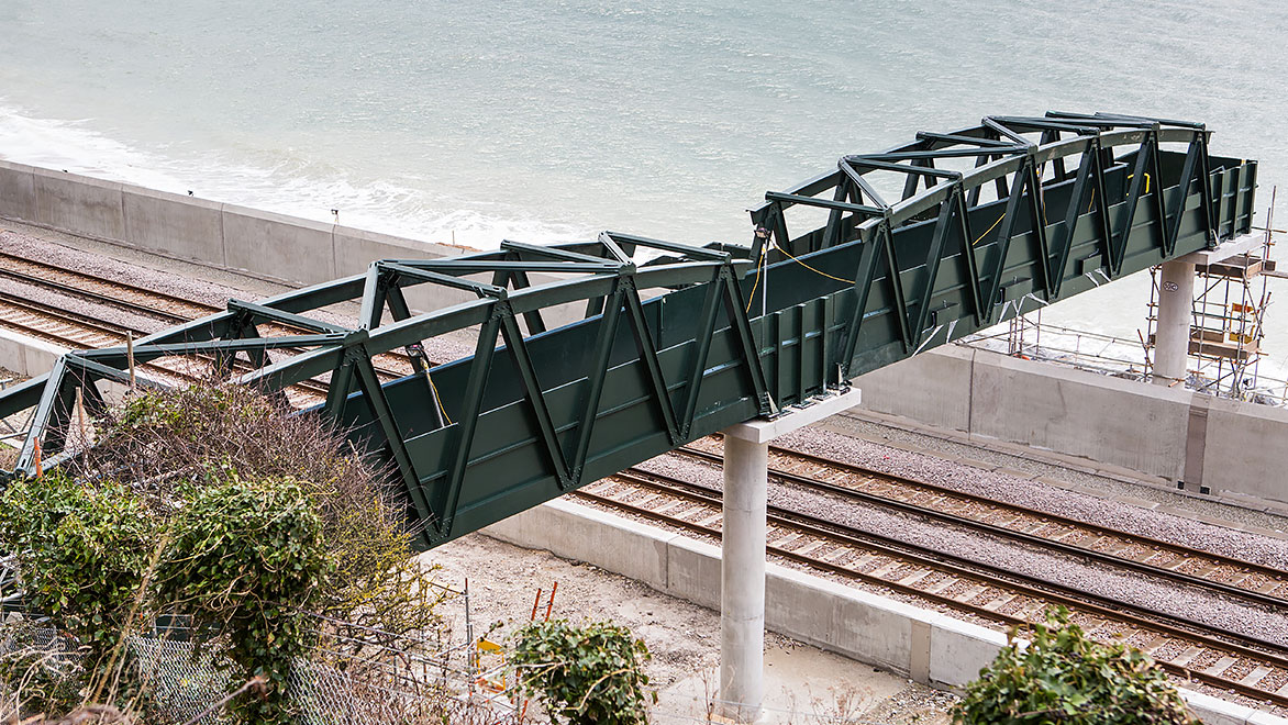 Image of fibre-glass footbridged designed and manufactured by NOV FGS and installed on the coast of Devon in the UK.