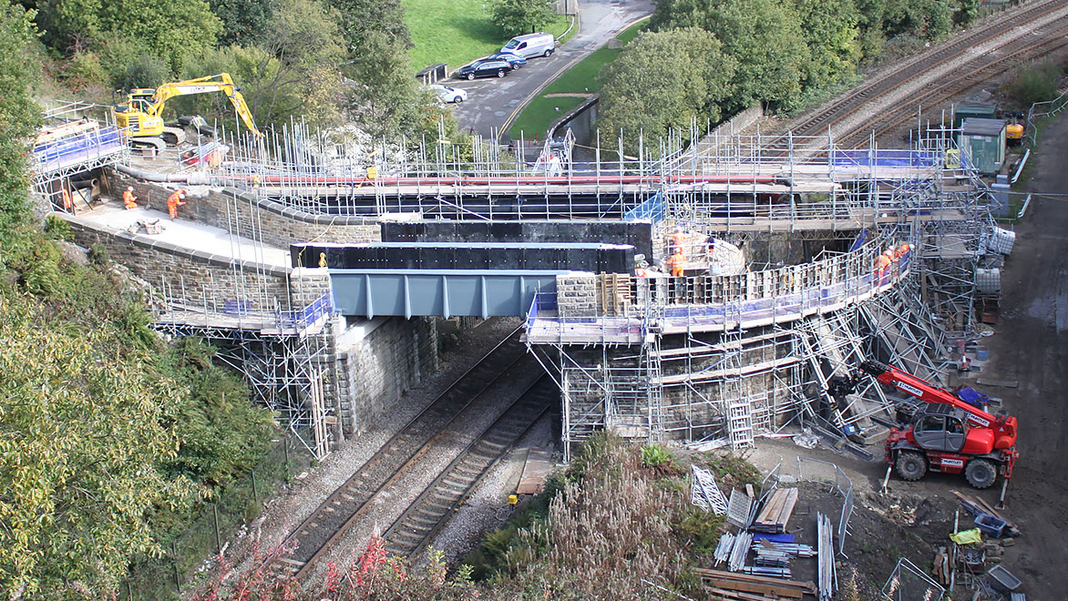 Image shows the installation of a large fibre-glass section of an aqueduct in Standedge, UK
