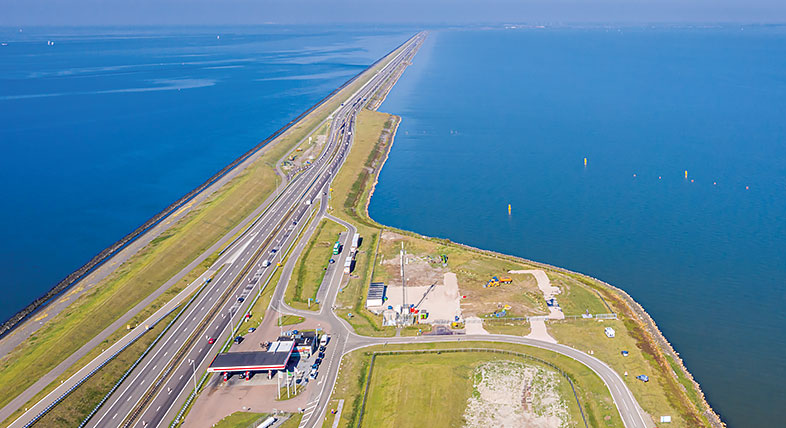 Aerial view of a highway crossing a body of water