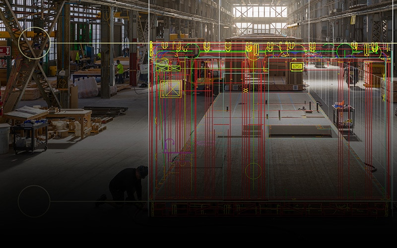 A digital design overlaid on a building under construction in the Factory_OS construction facility