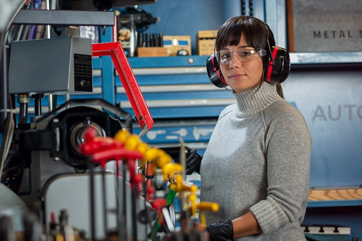Woman working in the metal shop at the Autodesk San Francisco Technology Center