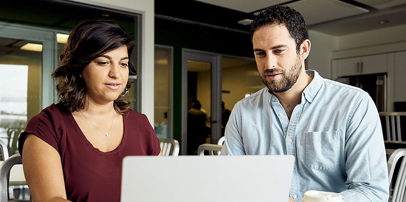 Two people reviewing designs