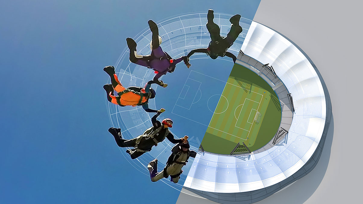 A group of 5 people skydiving into a soccer stadium.