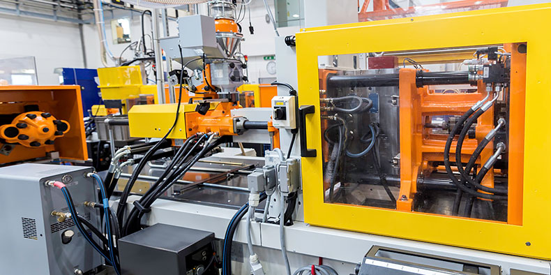 A technology laboratory with operating machinery integrated together via wires, cables, and cords.