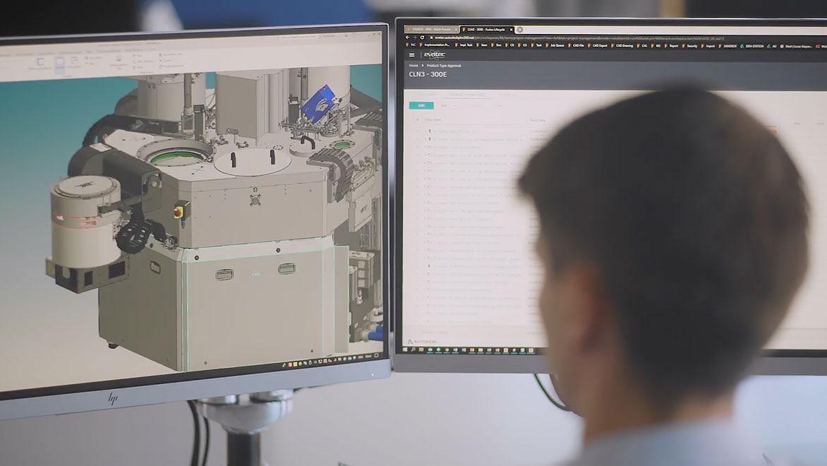 Man looking at computer screen Fusion 360 Manage software