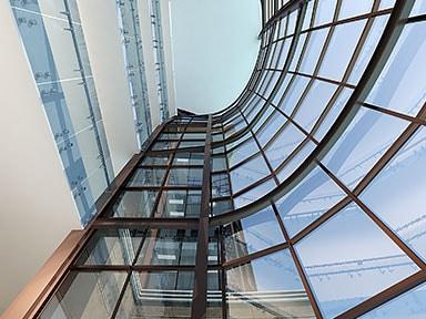 Ground level view of glass curved rotunda