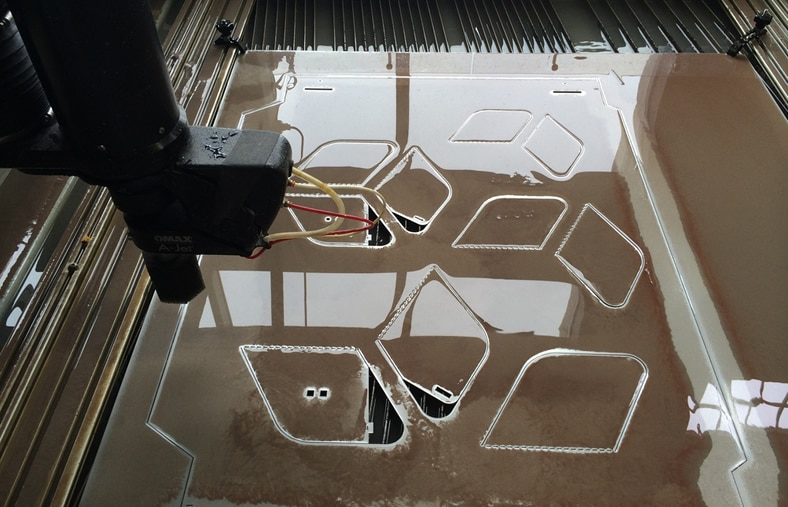 Digital fabrication of steel panels for CCA's Architecture In the Making project included the Omax waterjet