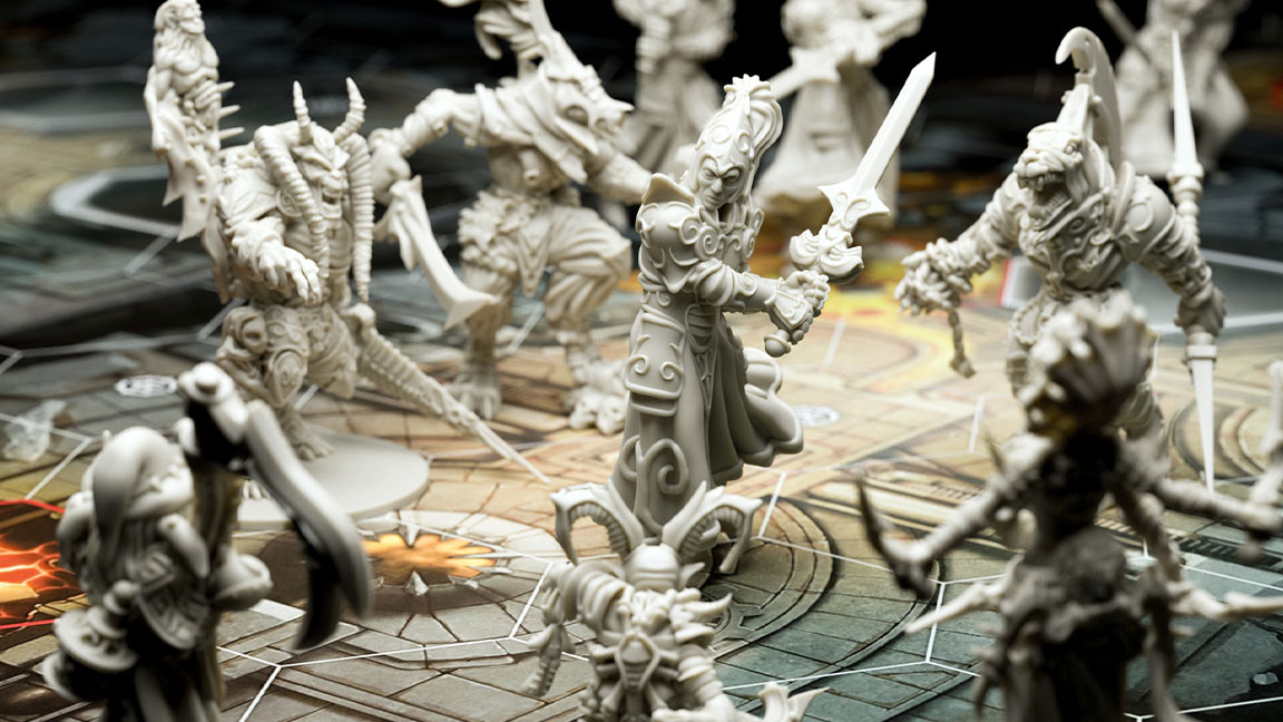 Intricate ivory-colored figurines including a knight wielding a sword with multiple armed monsters surrounding him