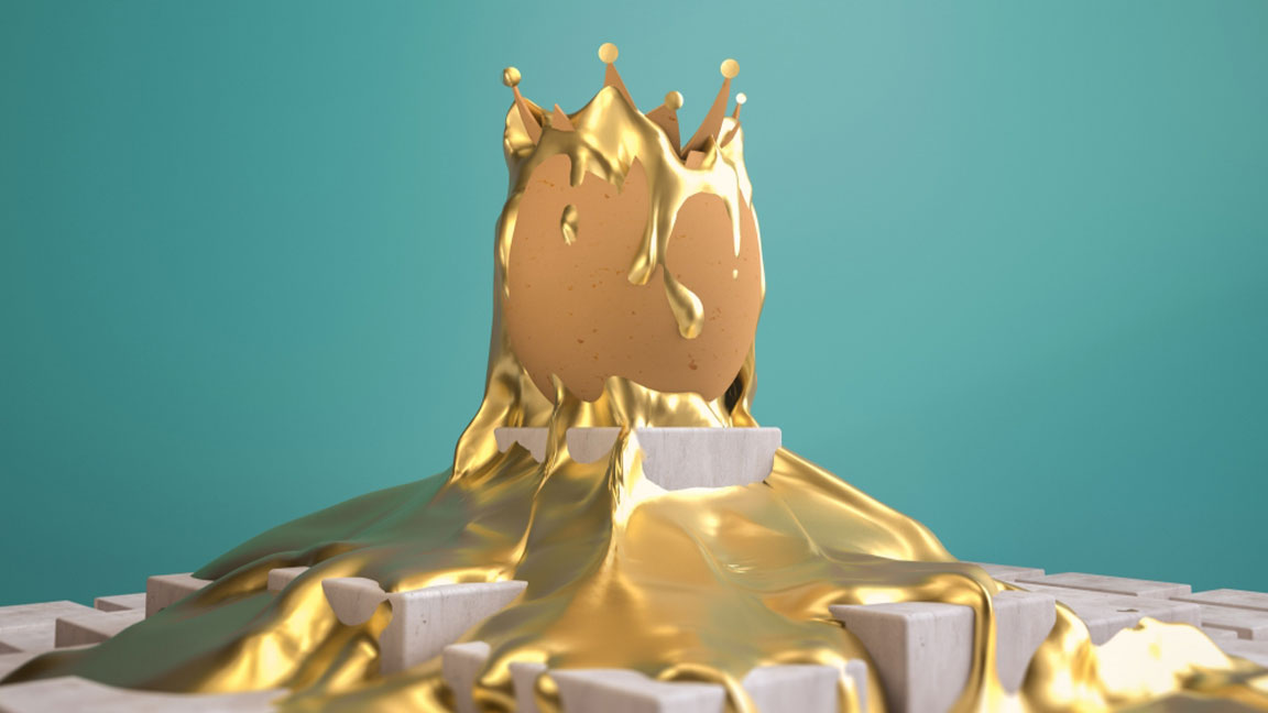 Brown egg cracked open on top, perched on a stone-colored block with gold liquid splashed around and on top of the egg