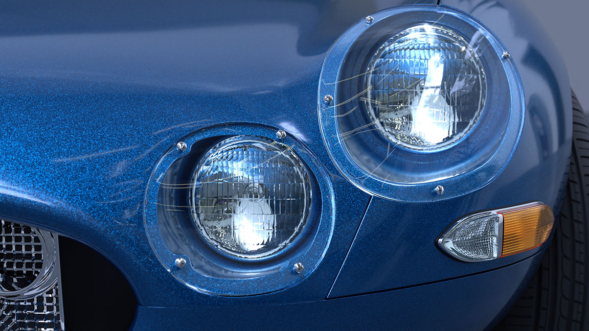 Close-up view of the left headlights of a bright blue car