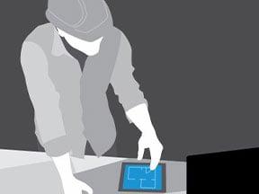 Eine Person greift über die AutoCAD Mobil-App auf Zeichnungen zu