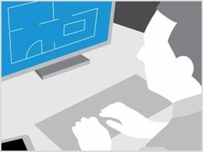 デスクトップ コンピュータで AutoCAD 図面を確認する作業者