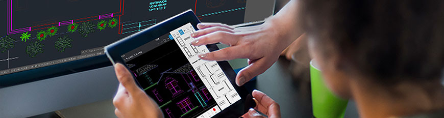 Two men sharing a tablet use core drafting tools in the AutoCAD mobile app