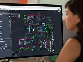Young woman in office using AutoCAD web app