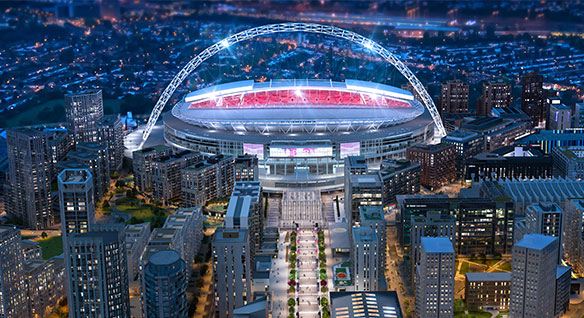 Detailed render of a reimagined Wembley stadium seen at night in a lit-up London