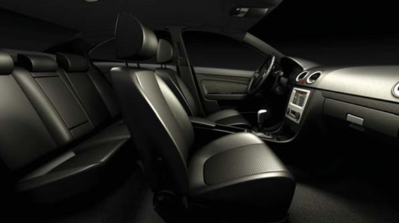 Interior shot of a car with black seats and silver-colored dashboard