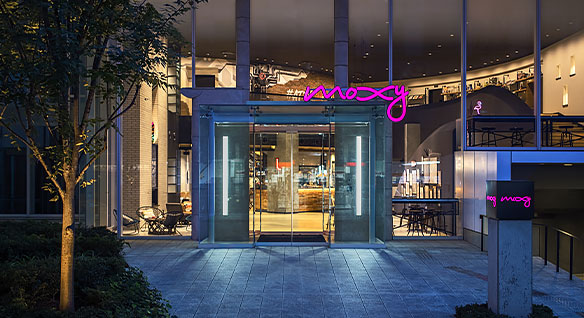 Glass entrance to the Moxy hotel