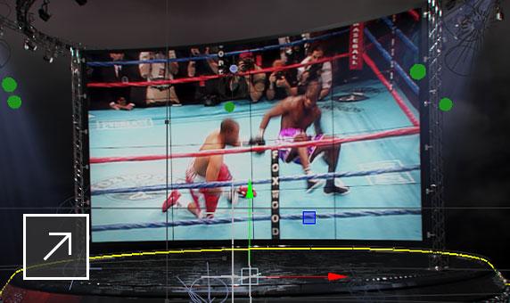 Flame 3D VFX ソフトウェアのユーザー インターフェイス。ステージ上の TV スクリーンに、リングで闘う 2 人のボクサーが映っているシーン