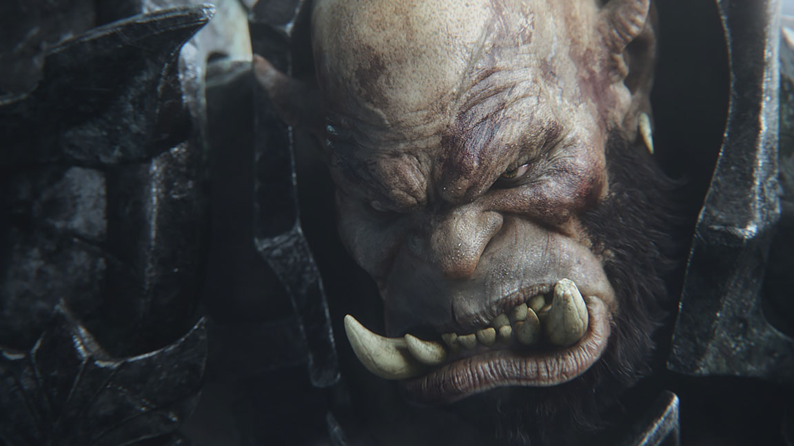 Close-up of angry orc face with huge tusks in underbite
