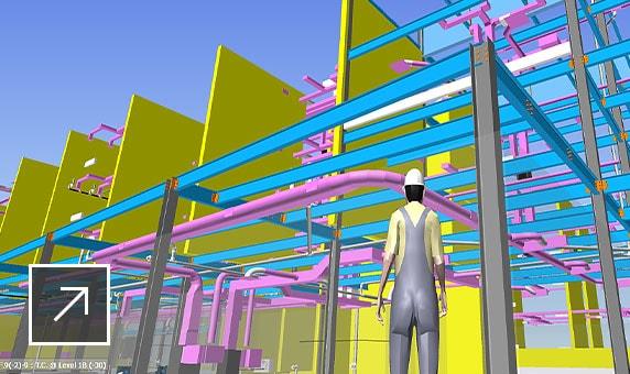 Modelo de projeto 3D com a pessoa renderizada olhando para tubulações, vigas e sistemas de construção codificados por cores