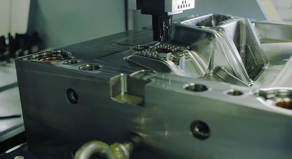 Electrical discharge machining being used to add small details to an injection mold tool