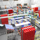 3D model of a factory assembly plant with conveyor system carrying ATVs
