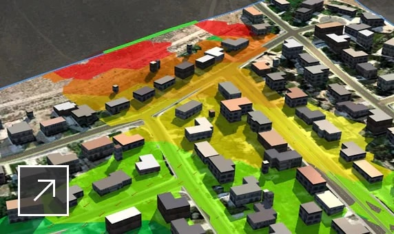 "InfraWorks 中的城市模型,其中打开了""洪水模拟""和""动画播放器""面板"