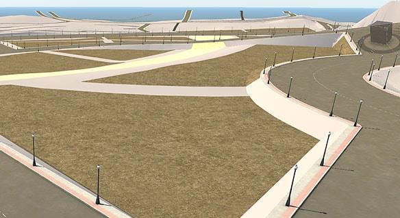 도로, 인도 및 풀밭을 보여주는 해변 개발의 진행 중 모형