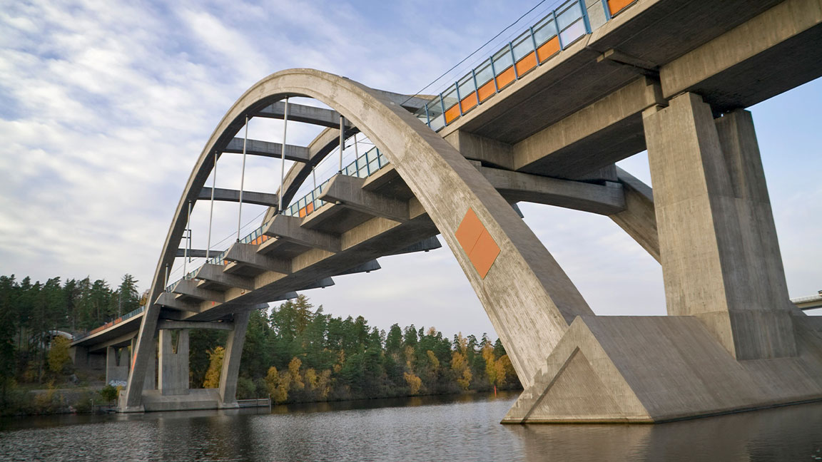 Intricate design of a modern railway arch bridge over water