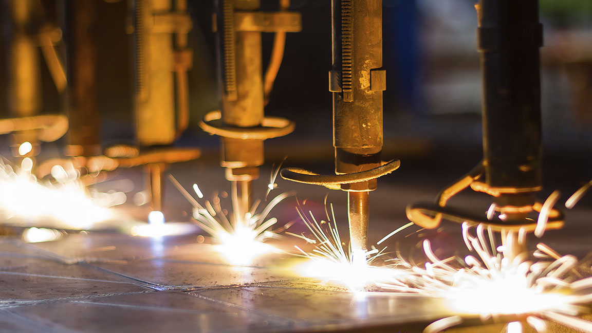 Photo of machinery drilling on a metal surface