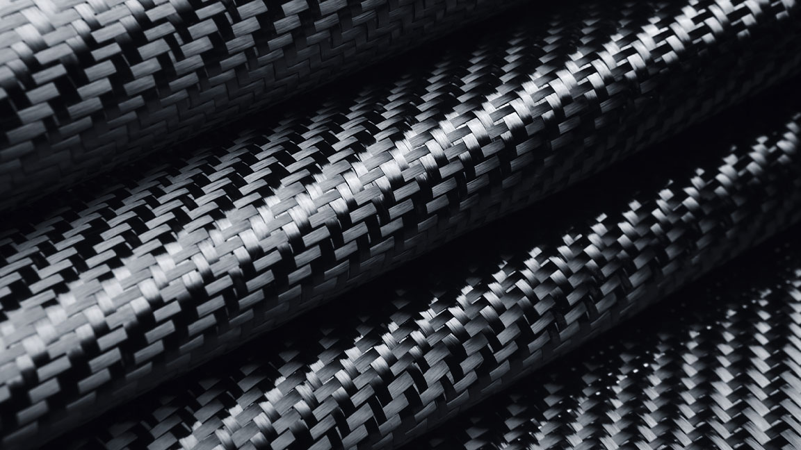 Close-up shot of the folds of a woven textile in black and grey