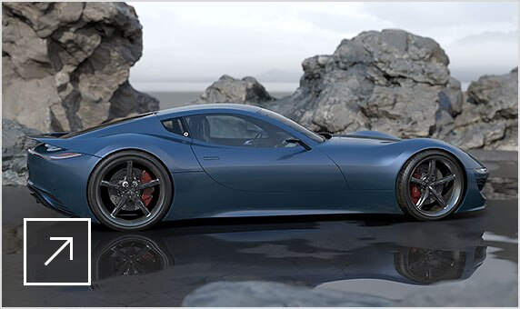 Prototype in VRED of a blue sports car on a beach, parked in front of craggy, slate grey boulders