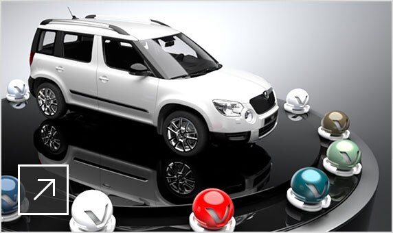 3D model of a white ŠKODA AUTO SUV on a raised platform encircled by spheres in different colours