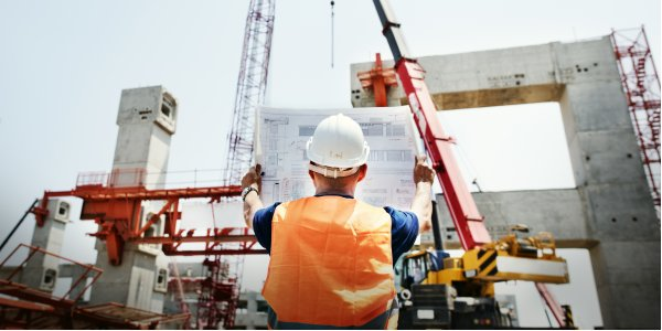 Construction worker reading a blueprint